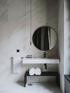 Ein Badezimmer in der Unterkunft El Môderne Hotel