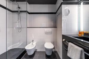 Ein Badezimmer in der Unterkunft Vienna House Diplomat Prague