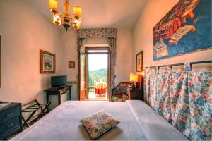 A bed or beds in a room at B&B Villa Garden