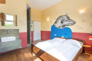 A bed or beds in a room at Sunflower Hostel Berlin