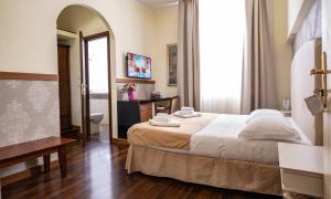 Кровать или кровати в номере Hotel Moderno