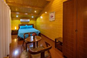 A bed or beds in a room at Welf Resort