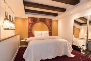 Een bed of bedden in een kamer bij Royal Boutique Apartment Amsterdam
