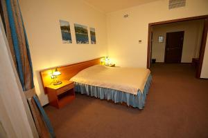 Кровать или кровати в номере Отель Лагуна