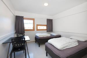 A bed or beds in a room at Anker Apartment – Sentrum