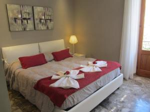 A bed or beds in a room at Affittacamere Da Paulin