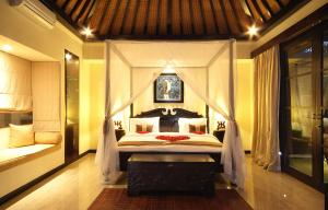 A bed or beds in a room at The Bli Bli Villas & Spa