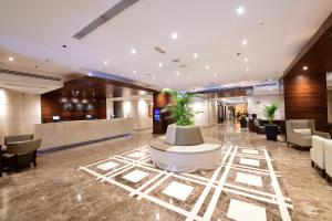 De lobby of receptie bij Majestic City Retreat Hotel ( Formerly Majestic Hotel Tower)