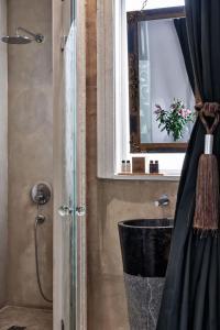A bathroom at Emporikon Athens Hotel