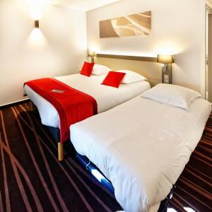 Un ou plusieurs lits dans un hébergement de l'établissement Hôtel AKENA BESANCON