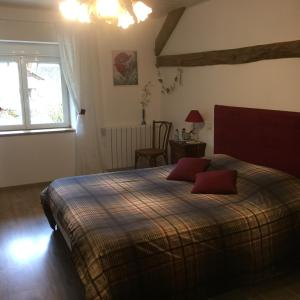 Un ou plusieurs lits dans un hébergement de l'établissement Le Chanois