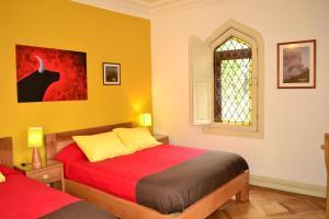 Cama ou camas em um quarto em Hostal Rio Amazonas