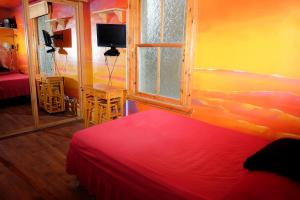 A bed or beds in a room at Shrimp Terrace