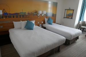 A bed or beds in a room at Best Western Carlton Hotel