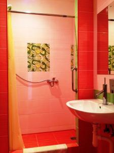 Vannas istaba naktsmītnē Motel Golden Fox