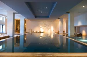 The swimming pool at or near Hotel Excelsior