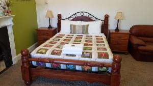 A bed or beds in a room at Suites On Avon