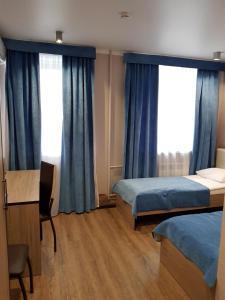 Кровать или кровати в номере Мини-отель Браво