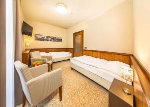 Postel nebo postele na pokoji v ubytování Hotel Zlatá hvězda
