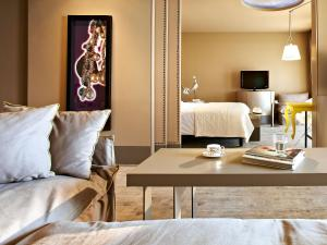 A bed or beds in a room at Grecotel Astir Alexandroupolis