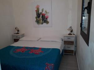 A bed or beds in a room at Casuzza cala pisana