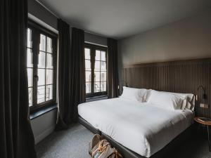 Ein Bett oder Betten in einem Zimmer der Unterkunft El Môderne Hotel