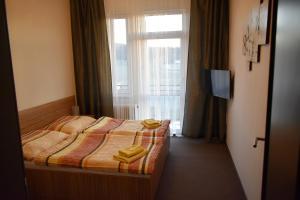 Postel nebo postele na pokoji v ubytování Hotel Vrchovina