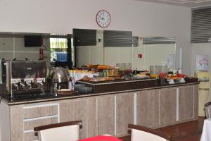 A kitchen or kitchenette at HOTEL D' LUCCA