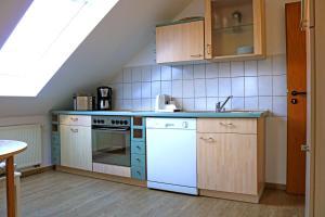Küche/Küchenzeile in der Unterkunft MOMENTS Boutique Hotel