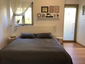 Cama o camas de una habitación en Apartment Check in