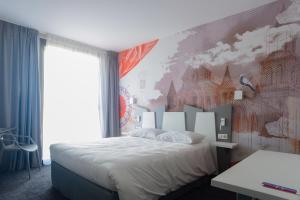 Un ou plusieurs lits dans un hébergement de l'établissement ibis Styles Poitiers Centre