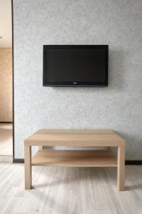 Телевизор и/или развлекательный центр в Квартира на Площади Ленина