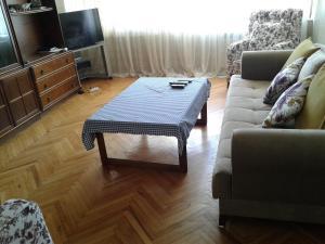 Uma área de estar em Хорошая Квартира в Центре 1