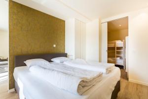 Un ou plusieurs lits dans un hébergement de l'établissement Hotel Donny