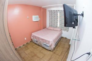 A bed or beds in a room at Apartamento Cidade Jardim