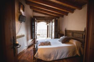 Cama o camas de una habitación en Casa Rural Therma Agreste
