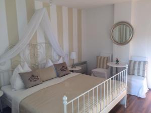 Ein Bett oder Betten in einem Zimmer der Unterkunft Das Cottage