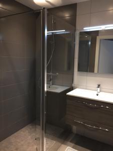 Een badkamer bij Résidence Froehn