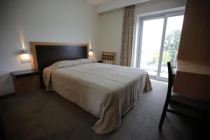 Uma cama ou camas num quarto em Hotel Recinto