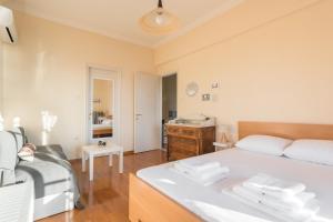 Ένα ή περισσότερα κρεβάτια σε δωμάτιο στο VillAlmyros