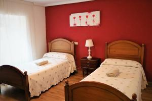 Cama o camas de una habitación en El Puntido