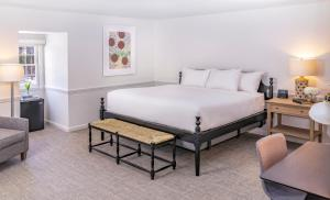 A bed or beds in a room at The Ellery