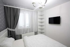 A bed or beds in a room at Apartmentrent