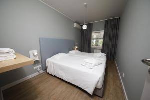 Uma cama ou camas num quarto em Montebelo Aguieira Lake Resort & Spa