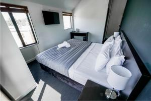 A bed or beds in a room at Base Queenstown
