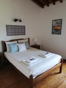 Un ou plusieurs lits dans un hébergement de l'établissement Quinta Dos Ribeiros