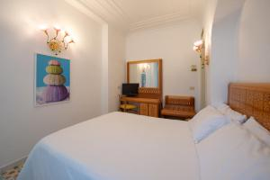Letto o letti in una camera di Grand Hotel Flora