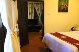 A bed or beds in a room at Niramaya Villa