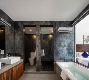 Ванная комната в Serendivi Resort Villa