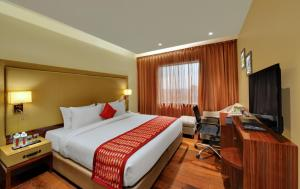 A bed or beds in a room at The Fern Residency Jaipur
